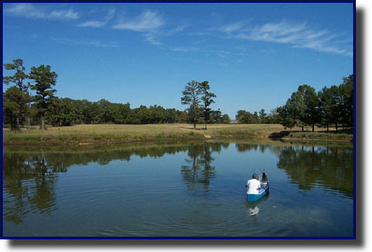 Fishing for largemouth bass in a rural retreat lake. Lamar County, TX