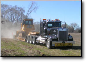 Heavy haul trucks arrive with Soilmovers LLC excavation equipment