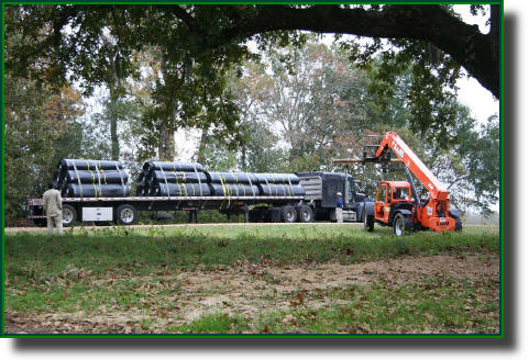 Geomembrane plastic lake liner being unloaded at our lake construction project near Oakwood, TX